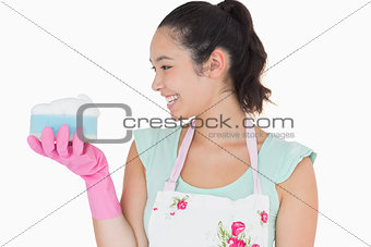Woman holding a sponge