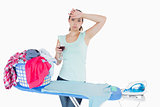 Woman drinking wine and ironing clothes