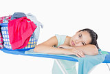 Woman with head resting on an ironing board