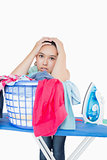 Woman getting frustrated from amount of ironing to do