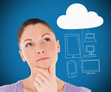 Woman thinking about media devices connecting through cloud computing