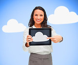 Woman standing holding a tablet pc showing cloud computing symbol