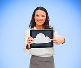 Businesswoman pointing to cloud computing symbol on tablet pc
