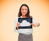 Woman pointing to cloud symbol on her digital tablet