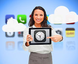 Businesswoman standing holding a tablet pc pointing to clock app symbol