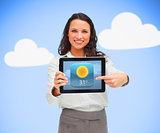 Woman standing holding a tablet pc against blue background pointing to weather app