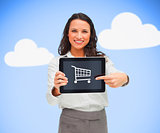 Businesswoman holding a tablet pc while smiling showing trolley symbol