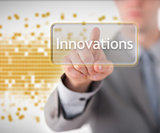 Businessman pointing to the word innovations