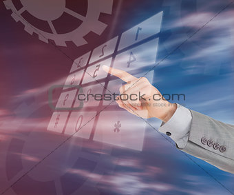Businessman typing on holographic number pad