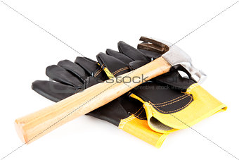 Two builder's gloves and a hammer