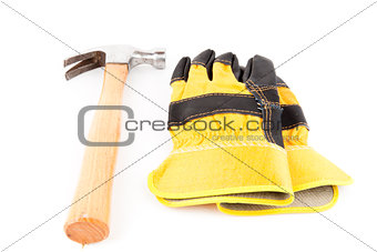Pair of builder's gloves and hammer