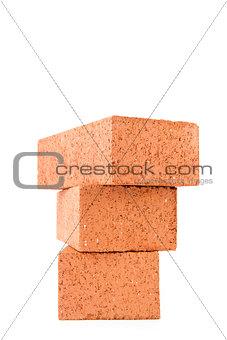 Stack of three clay bricks