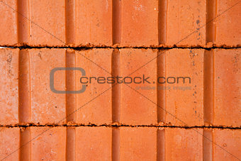 Stack of clay bricks building a wall