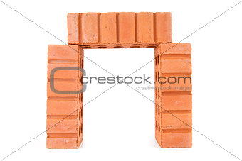 Three stacked red bricks