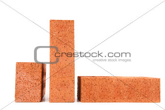 Three clay bricks in different sizes