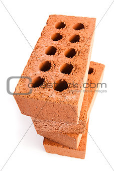 Four clay bricks being stacked