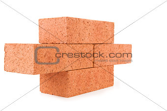 Four clay bricks stacked as a part of a wall