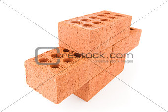 Four red bricks stacked as a part of a wall