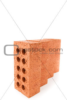Four clay bricks positioned in a row