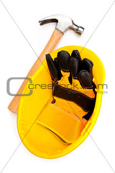 Two leather gloves in a helmet with a hammer