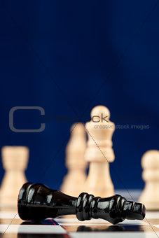 Black chess piece lying