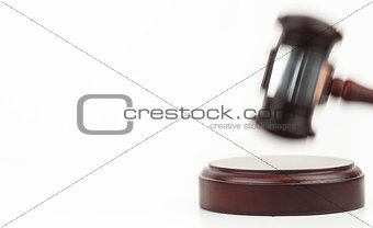 Moving gavel banging on a sound block