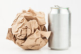 Empty can and crushed paper bag