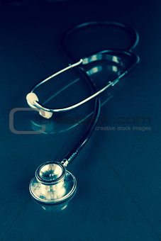 Black stethoscope in the dark