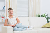 Blonde woman relaxing on couch