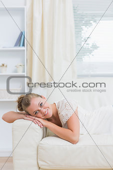Blond woman lying on the couch