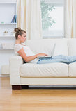 Woman working on laptop in the living room