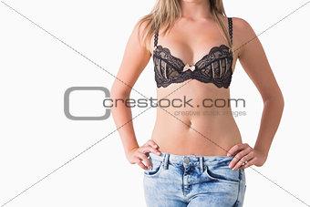 Blonde woman holding her waist