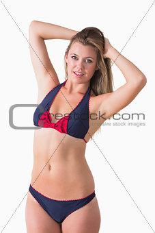 Blonde shaking her hair while wearing bikini