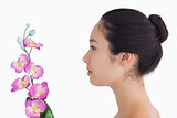 Woman looking at orchids