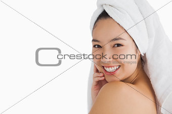 Woman with towel touching her skin