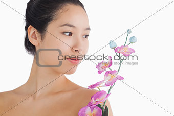 Woman looking at a bouquet of orchids