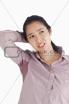 Embarrassed woman with sweat patches