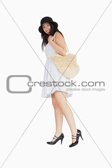 Smiling woman in dress turning away