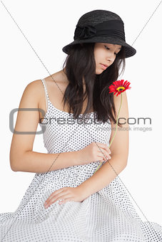 Woman looking at a flower