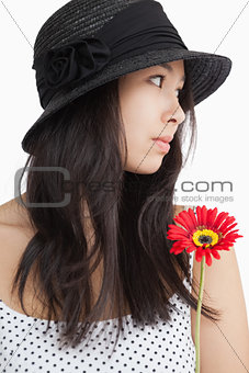 Woman with flower looking away