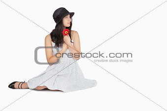 Woman sitting on the floor looking away