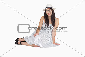 Woman sitting on the floor wearing glasses