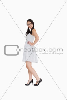 Smiling woman with a white polka dot dress