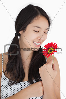 Woman in pigtails holding flower