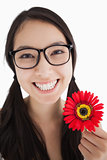 Happy woman holding a flower with glasses