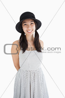 Cheerful woman with a polka dot dress and hat