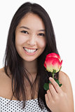 Smiling woman with rose