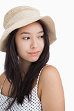 Woman with a straw hat looking away