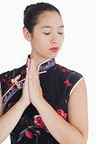 Woman in kimono closing her eyes