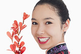 Woman in kimono smiling with flower